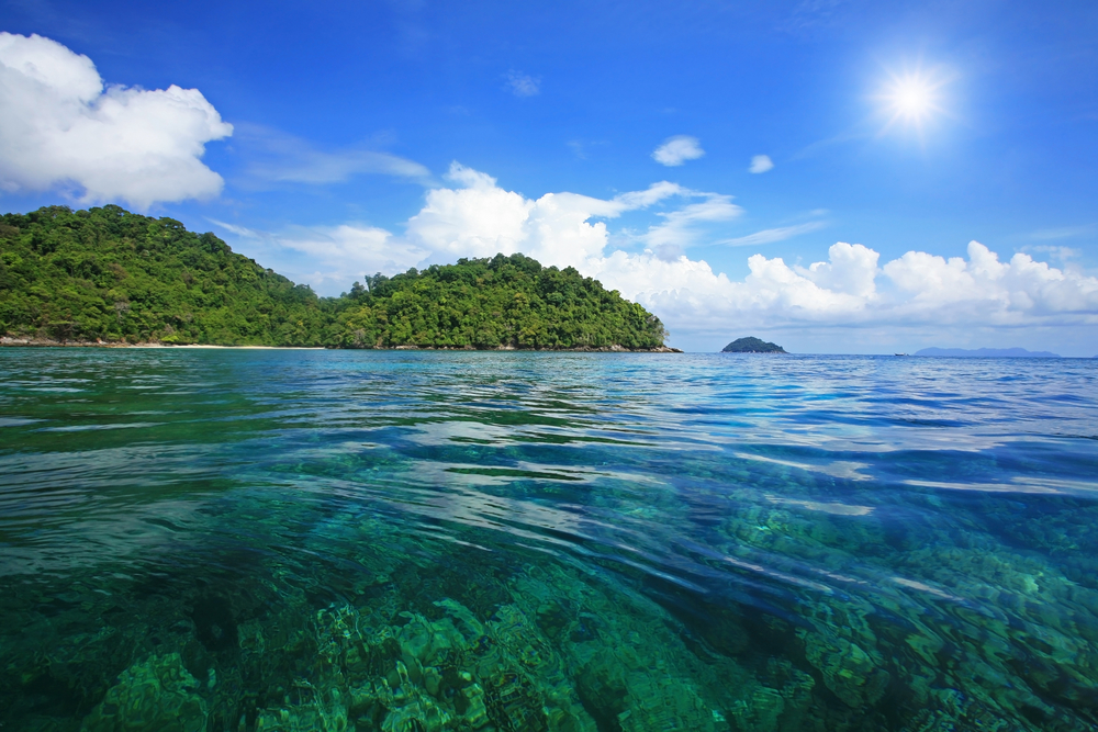Snorkel spot against blue sky and sunbeam at Koh surin island ,Phang Nga, Thailand