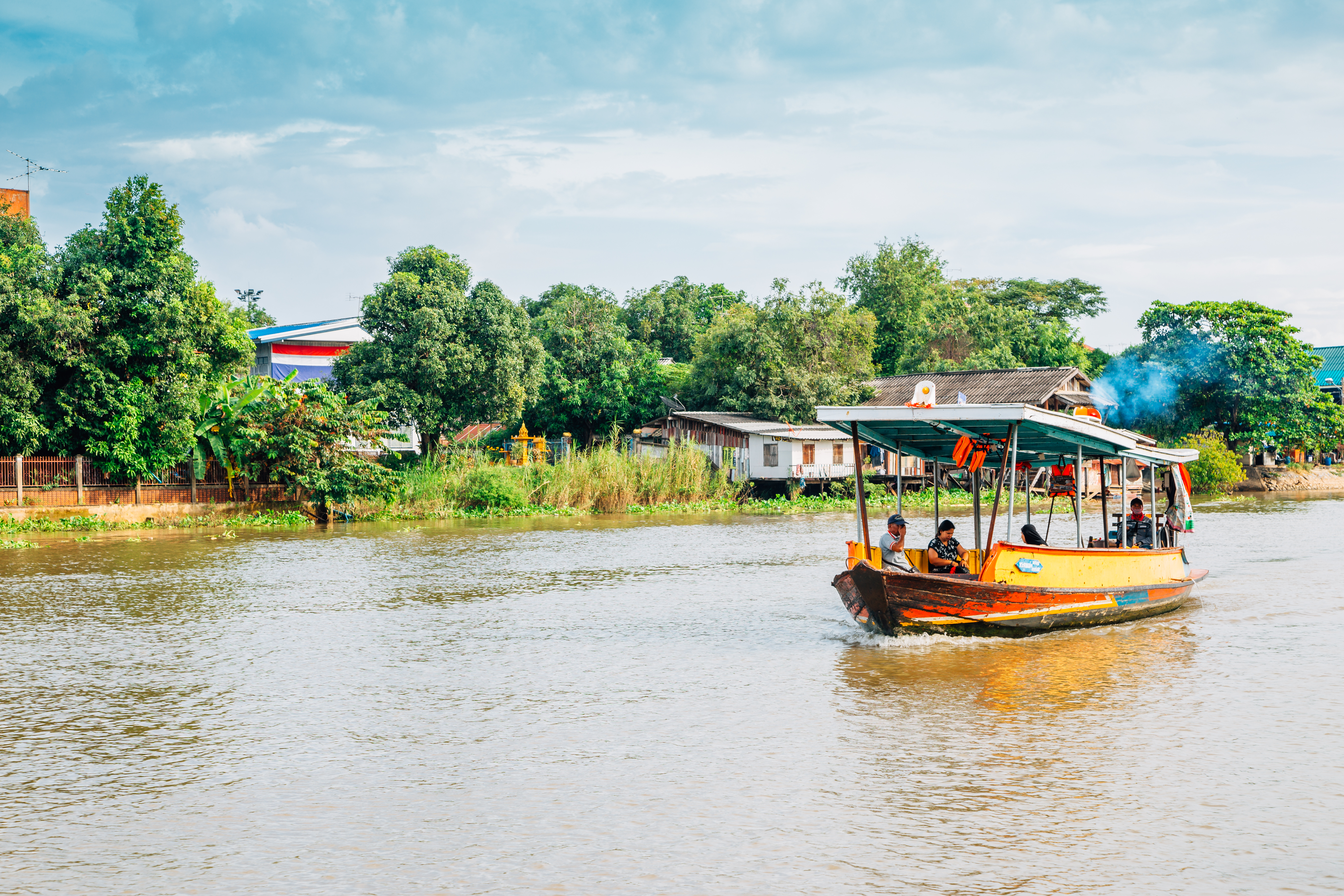 Ayutthaya, Thailand - November 9, 2017 : Old boat crossing the Pa Sak River at Ayutthaya train station pier