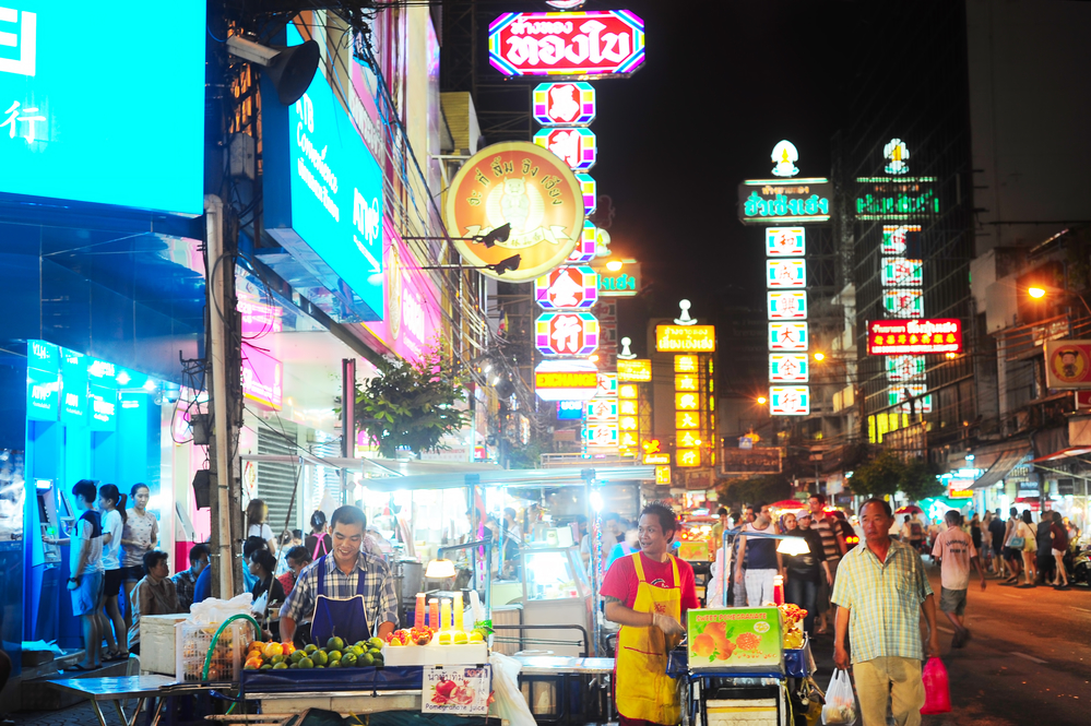 Bangkok, Thailand - March 03, 2013: People at Yaowarat Road in the evening in Bangkok. Yaowarat Road is a main street in Bangkok's Chinatown, it was opened in 1891 in the reign of King Rama V.