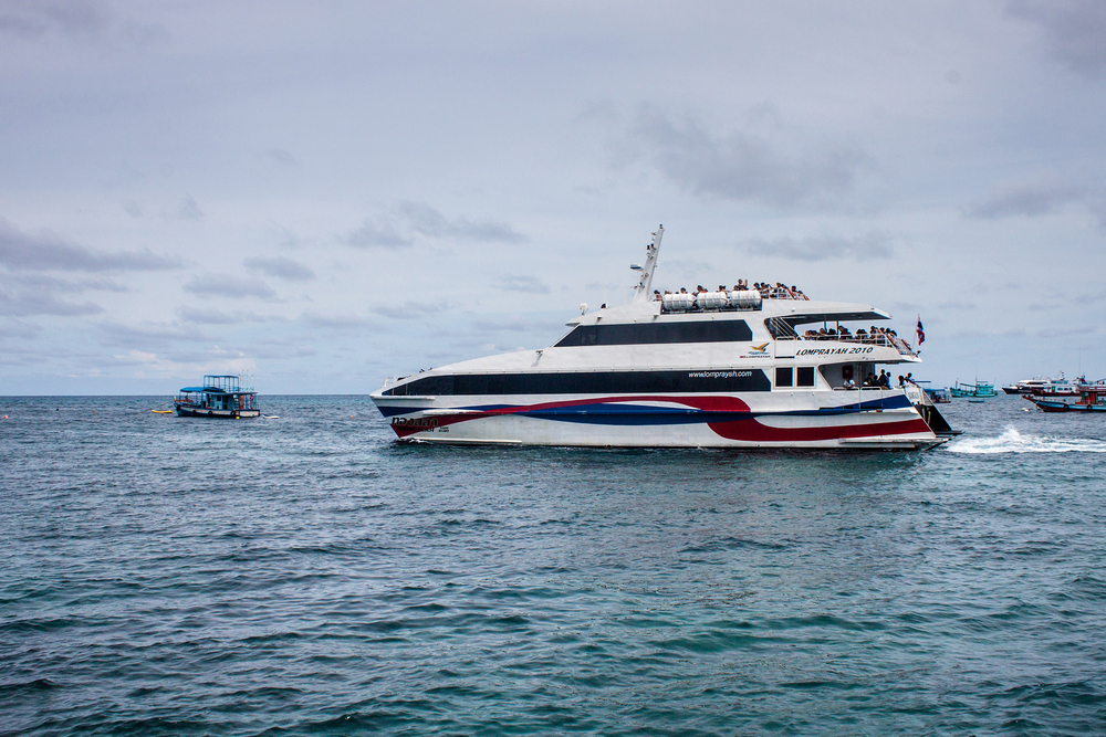 KO TAO, THAILAND - AUGUST 31: Lomprayah high speed catamaran leaves Ko Tao, Thailand on August 31, 2013. Lomprayah is one of ferry companies in Gulf of Thailand