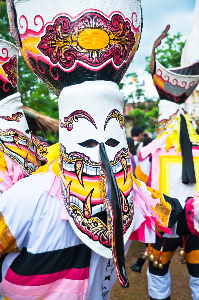 LOEI , Thailand - JULY  2011 : Unidentified men wear ghost costumes at Ghost Festival (Phi Ta Khon - a masked procession celebrated by Buddhist)  on July 02, 2011 in Loei Province, Thailand.