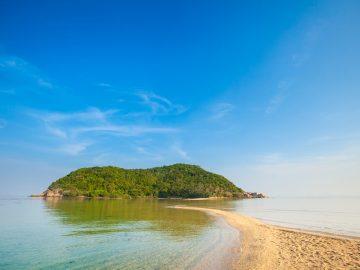 Summer seascape on tropical island Koh Phangan in Thailand. Mae Haad beach and Koh Ma landscape.