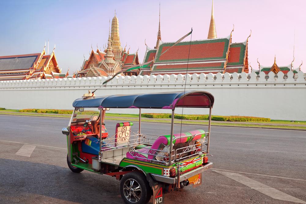BANGKOK - MARCH 3: Tuk Tuk taxi waiting customers about Wat Phra Kaeo, Temple of the Emerald Buddha and the home of the Thai King in Bangkok, March 3, Thailand